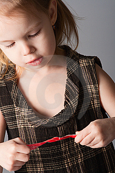 Girl Look At Ribbon. Royalty Free Stock Photos - Image: 8136088