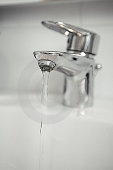 Water Tap With Focus On Water Coming Out Of Tap Royalty Free Stock Photos - Image: 8136108