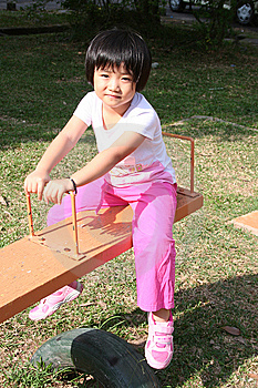 Girl On Seesaw Stock Photo - Image: 8139630