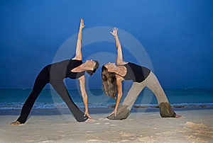 Mother And Daughter Doing Yoga Royalty Free Stock Photo - Image: 8142355