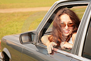 Woman Smiles In A Car Window Stock Photo - Image: 8146990