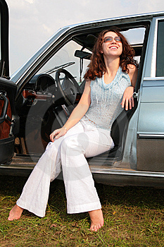 Woman Sits In The Car Stock Photos - Image: 8147203