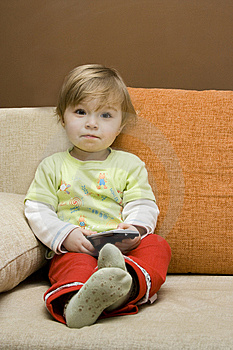 Baby Girl With Remote Control Royalty Free Stock Images - Image: 8147959