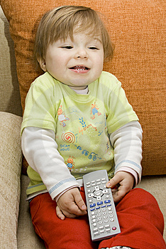 Baby Girl With Remote Control Royalty Free Stock Image - Image: 8147976