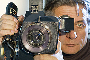 Cameraman  And Camera. Royalty Free Stock Images - Image: 8152069