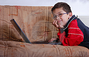 Kid And Laptop Royalty Free Stock Photo - Image: 8163325