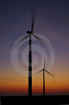 Sunrise And Spinning Wind Turbines Royalty Free Stock Photos - Image: 8169608