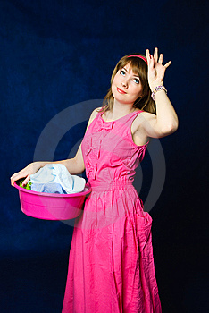 Tired Housewife With A Basin Full Of Clothes Royalty Free Stock Photos - Image: 8176328