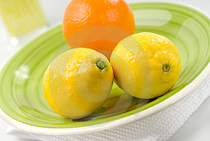 Orange And Lemons On Green Plate Stock Images - Image: 8179934