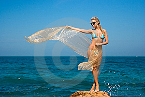 Lady On Rocky Beach Royalty Free Stock Photos - Image: 8180618