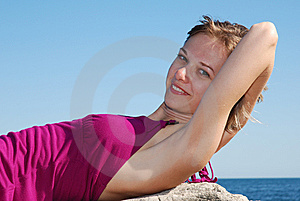 Beautiful Blonde Lying On The Rock Royalty Free Stock Photos - Image: 8181688