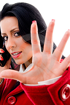 Woman Talking On Phone And Showing Stopping Royalty Free Stock Image - Image: 8184006