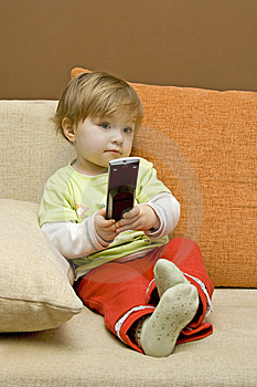 Baby Girl With Remote Control Stock Photos - Image: 8191213