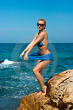 Lady On Rocky Beach Royalty Free Stock Images - Image: 8193609