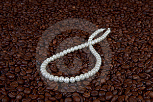 Pearl Beads In Coffee Beans Royalty Free Stock Photography - Image: 8209027