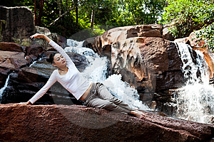 Young Woman Relaxing By The Waterfall Stock Image - Image: 8225781