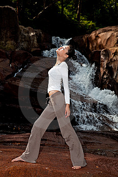 Young Woman Relaxing At The Waterfall Stock Photography - Image: 8225882
