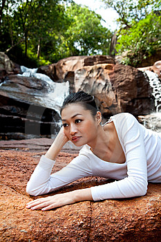 Young Woman Relaxing By The Waterfall Royalty Free Stock Photos - Image: 8226198