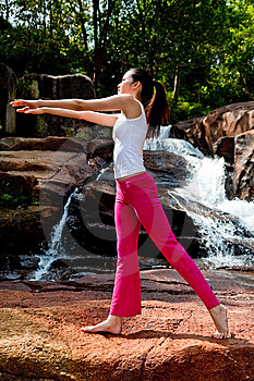 Young Woman Relaxing At The Waterfall Royalty Free Stock Photography - Image: 8226377