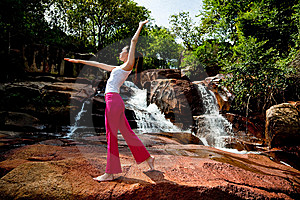 Young Woman Relaxing At The Waterfall Royalty Free Stock Photos - Image: 8226468