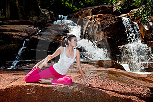 Young Woman Relaxing By The Waterfall Stock Images - Image: 8226544