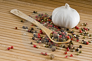 Spoon Of Aromatic Peppers And Garlic Royalty Free Stock Photos - Image: 8227118