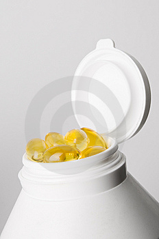 Medicine Container With Yellow Pills Royalty Free Stock Photography - Image: 8231407