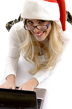 Woman In Christmas Hat Working On Laptop Stock Photography - Image: 8244112