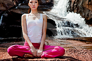 Young Woman Relaxing By The Waterfall Royalty Free Stock Images - Image: 8244409