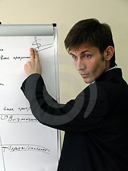 Businessman Pointing To The Drawing Dollar Sign Royalty Free Stock Images - Image: 8250899