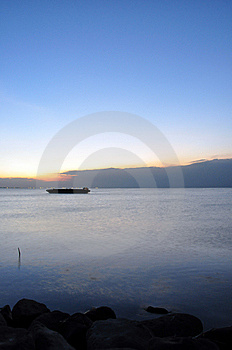 A Lone Barge And Sunset Stock Photography - Image: 8255572