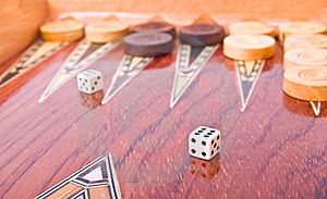 Ivory Dices On Wooden Handmade Backgammon Board Stock Images - Image: 8260914