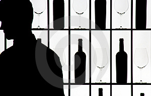 Silouette Of A Waiter Against Bottle And Glasses Stock Photography - Image: 8261602