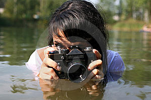 Photographer In Water Stock Photography - Image: 8262212