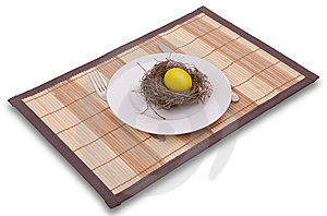 Gold Egg In A Nest Served On A Plate Stock Image - Image: 8269261