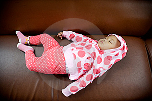Baby Sleeping On A Sofa Stock Photos - Image: 8275633