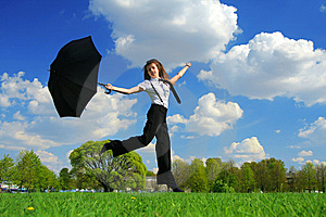 Woman Jumping On The Field Stock Photo - Image: 8276160