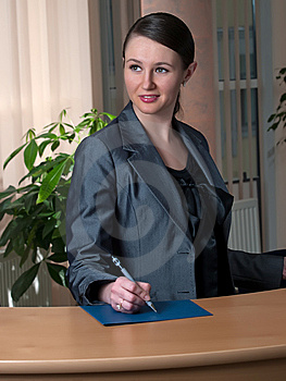 Young Attractive Business Woman Take A Pen Stock Images - Image: 8282184
