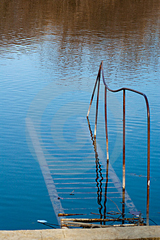 Rusty Staircase Going Nowhere In The Water Stock Images - Image: 8287034