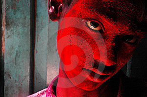 A Boy's Face Smeared With Colour Stock Image - Image: 8298481
