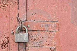 Lock on an old red gate