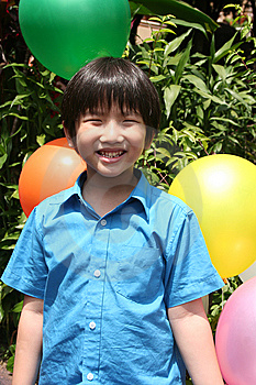 Boy Holding Balloons Stock Photo - Image: 8315340