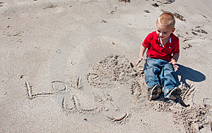 Young Boy Writing In Sand. Royalty Free Stock Images - Image: 8321609