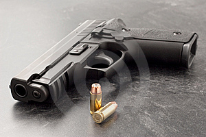 Handgun And Bullets Royalty Free Stock Image - Image: 8323076