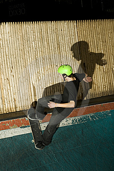 Skateboarder Going Up Ramp To Do A Trick Royalty Free Stock Image - Image: 8337196