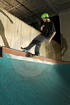 Skateboarder Doing A Trick On Ramp Royalty Free Stock Photography - Image: 8337387