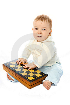 Baby With A Chessboard Royalty Free Stock Photography - Image: 8344257