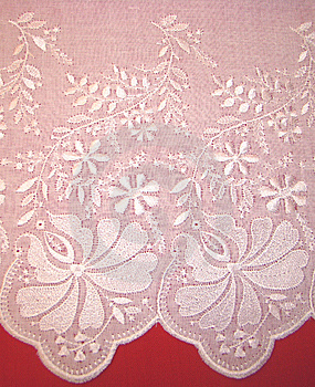 Embroidery Rishelye On A White Batic Stock Image - Image: 8346041