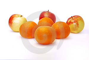 Four Mandarines And Three Apples Royalty Free Stock Image - Image: 8348636