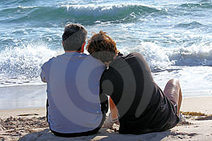 Couple Sitting On The Beach Royalty Free Stock Images - Image: 8364509
